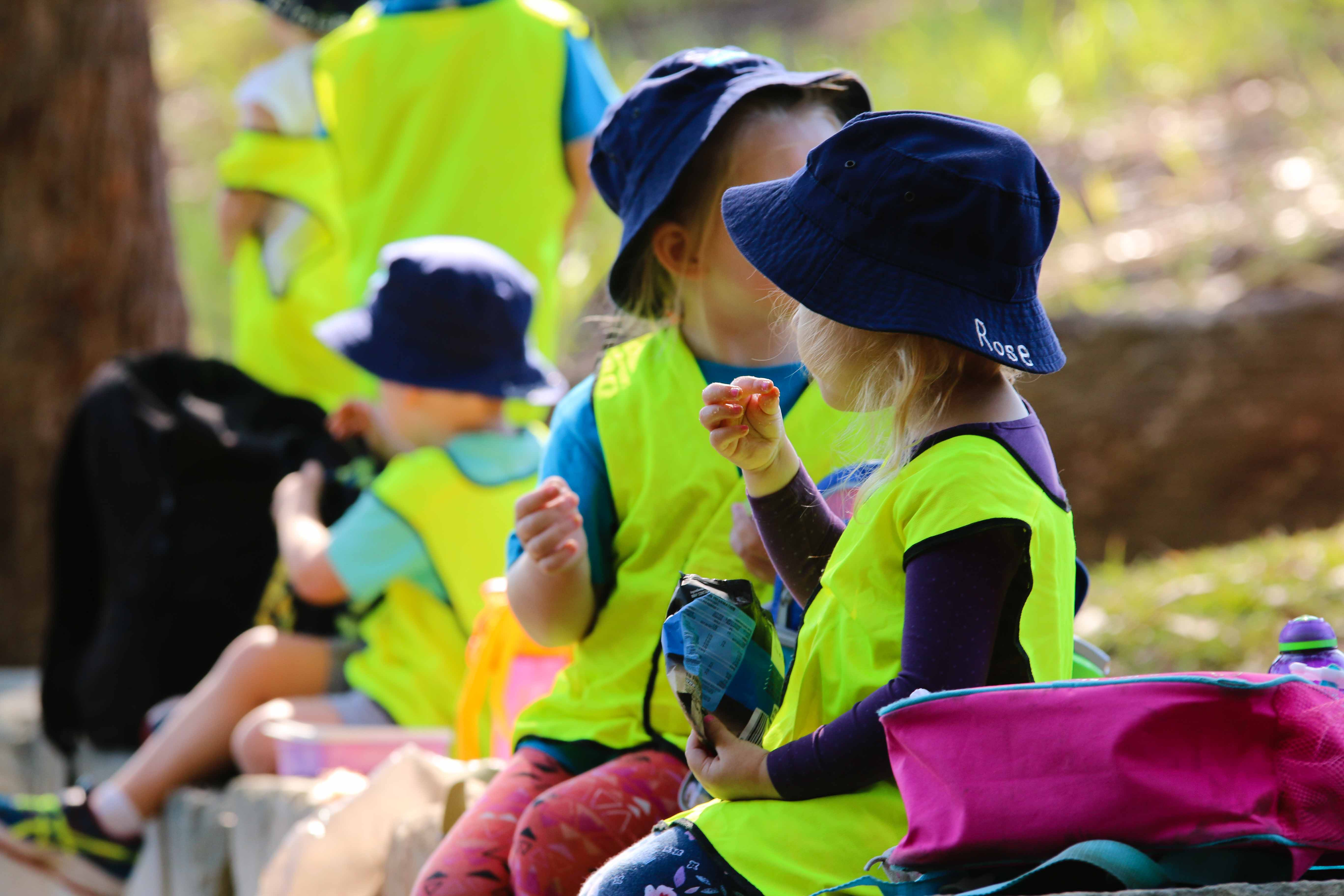 Kindy students eating moring tea at Bush Kindy - Suncoast Little Learners