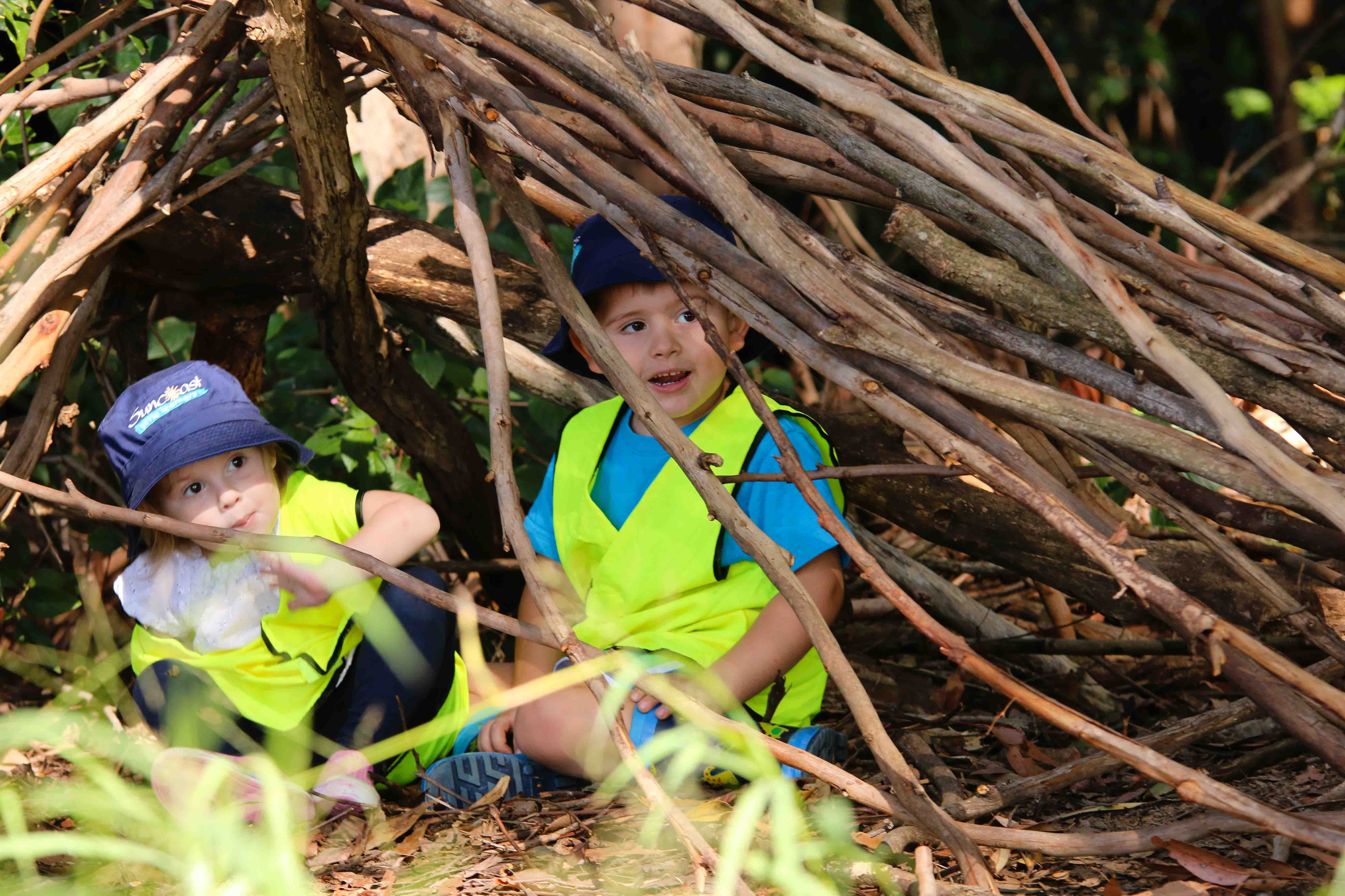 Kindy students playing in cubby house during Bush Kindy at Suncoasst Little Learners