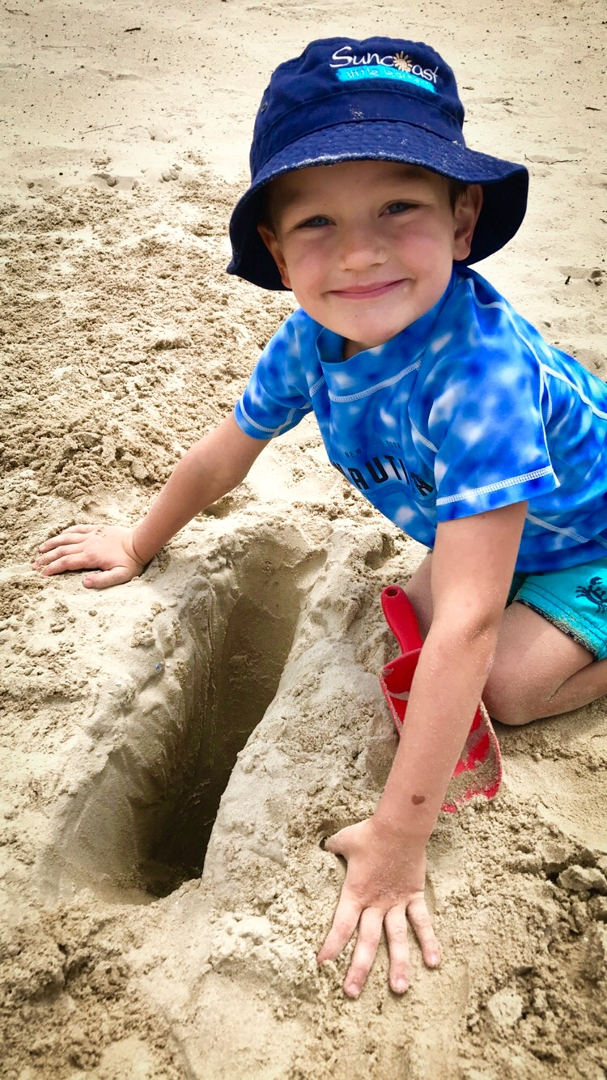 Beach Kindy - Suncoast Little Learner digging in sand